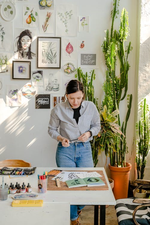 A woman drawing in a workspace